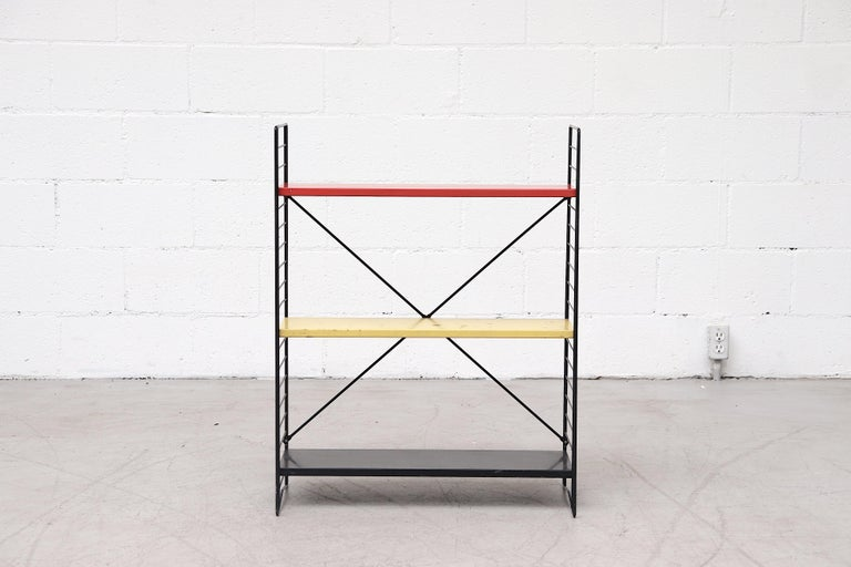 Industrial Tomado book shelf with red, yellow and black metal enameled shelves on black enameled wire frame. Versatile and stylish with adjustable shelves. Shelf depth is approximate 8