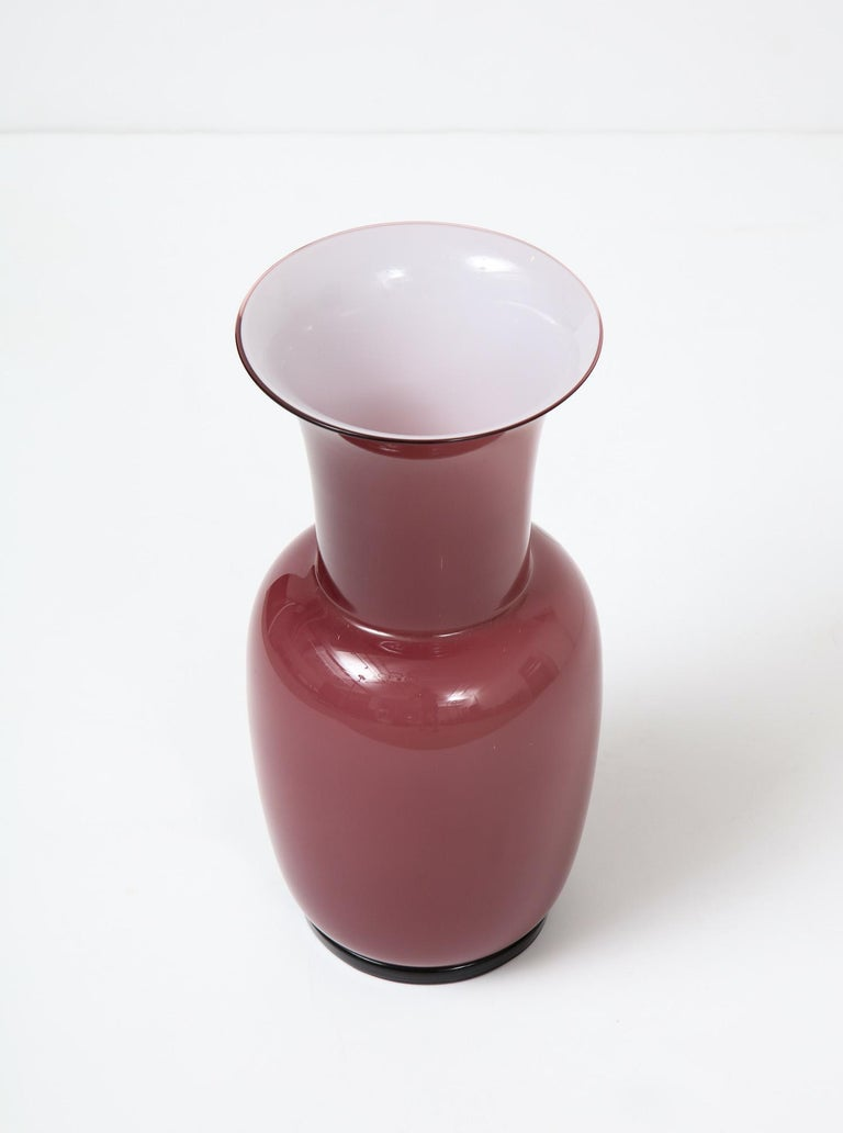 """""""Incamiciato"""" vase by Tomaso Buzzi for Venini, 1933-1984. Designed in the 1930s this example was executed in 1984. Cased-glass vase of mauve exterior and white interior. Hand blown form on a short, footed base. Etched signature and dated underneath,"""