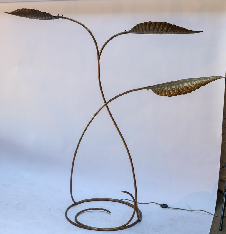 1970s Italian brass floor lamp by Tommaso Barbi with three leaves / lights on a circular base.  Base diameter: 26.5