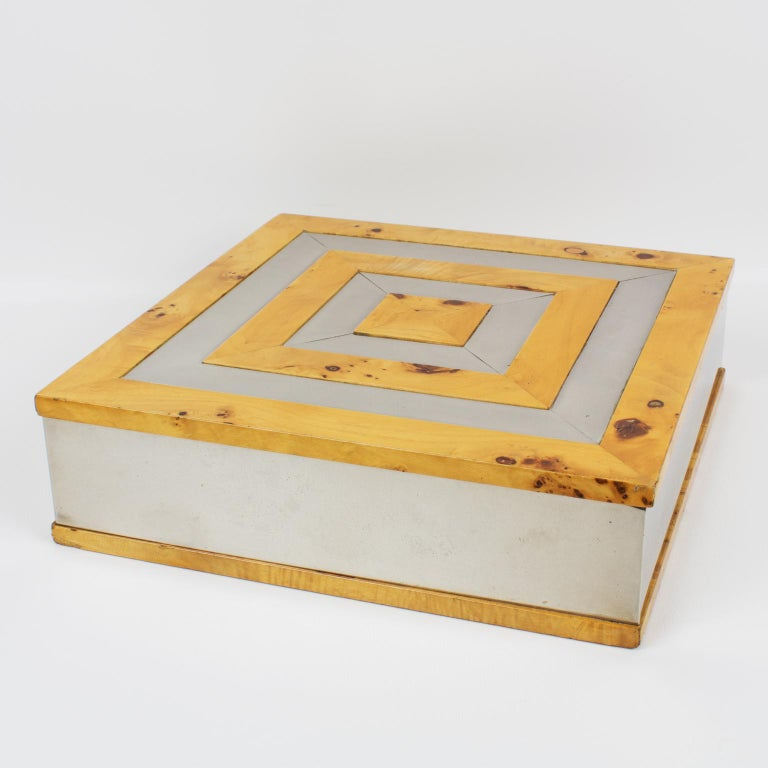 Great looking original decorative box designed by Tommaso Barbi, Italy. Modernist design with square shape and chromed metal and burl birch wood geometric marquetry on the lid. Inside is in burl wood as well, with compartments. A box with a lot of