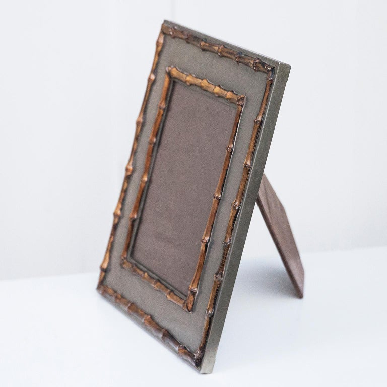 Hollywood Regency pictures frames in metal and bamboo made and signed by Tommaso Barbi, Italy, 1970s.
