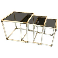 Tommaso Barbi Set of Three Brass and Smoked Glass Nesting Side Tables, 1970