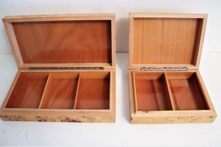 Beautiful set of two pieces of decorative boxes made of burl wood outside and beech-wood inside. The smaller one still with original label. Excellent craftsmanship.  Both boxes have a very stylish and timeless design and would make any lover of