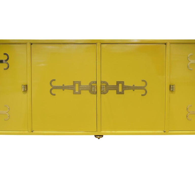 Mid-20th Century Tommi Parzinger Exquisite Credenza with Iconic Brass Hardware, 1950s For Sale