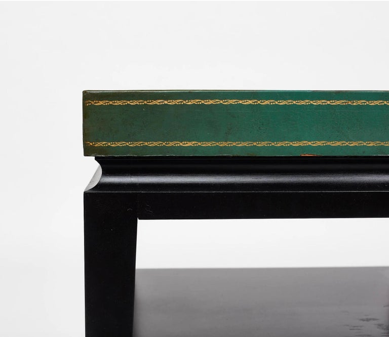 Tommi Parzinger green leather occasional table, model no. 3303, ca. 1955 Ebonized wood, embossed leather. Manufactured by Charak, USA.  Measures: 26