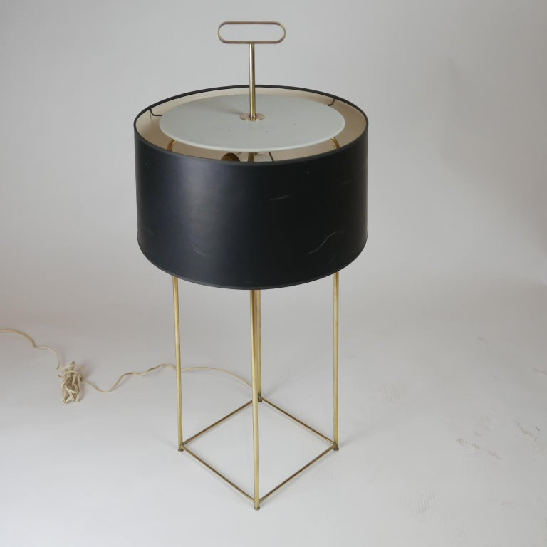 Tommi Parzinger originals model (19) table lamp with original shade and beautiful patina on brass . A seldom offered lamp that comes from the original owner in beautiful condition.