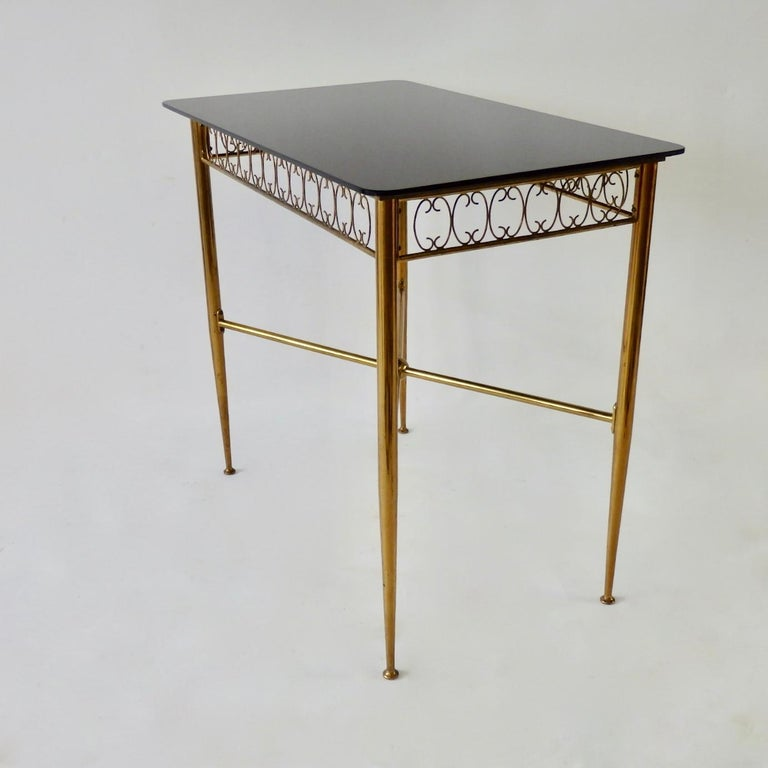 Most likely Italian made brass base table. Black Vitrolite glass top.