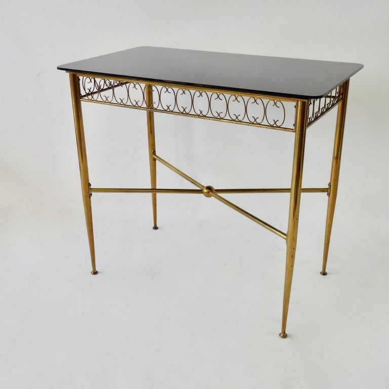 20th Century Tommi Parzinger Style Brass Base Vitrolite Glass Top Console Table For Sale