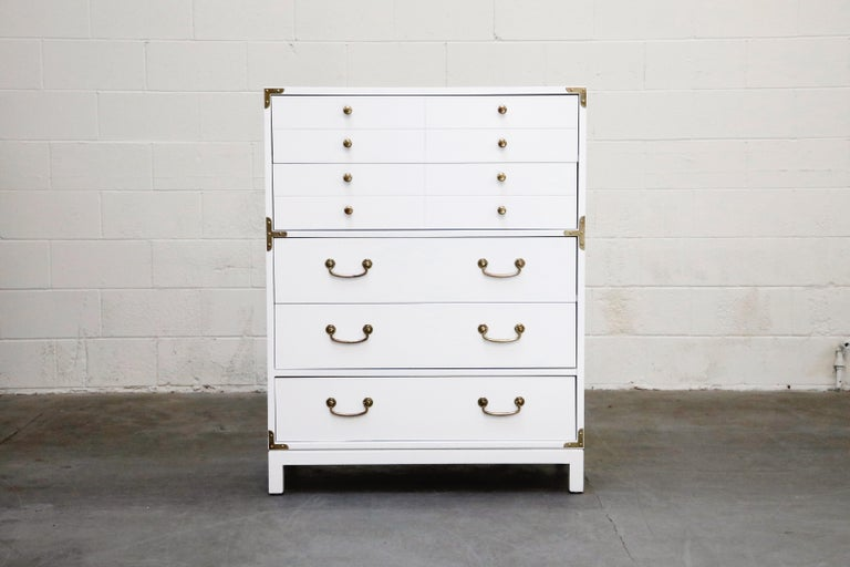 This gorgeous 'Barbados' Campaign dresser by Drexel features gleaming white lacquer and brass Campaign styled hardware and pulls. Lots of Tommi Parzinger for Parzinger Originals style injected into this Mid-Century Modern Campaign piece by quality