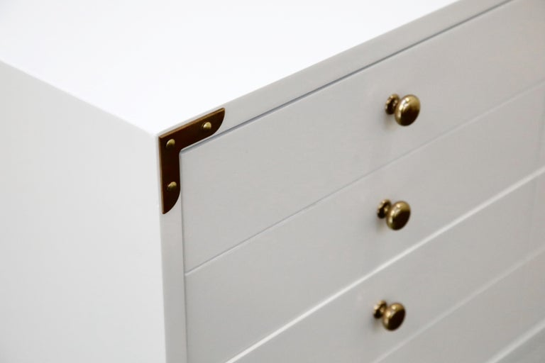 Wood Tommi Parzinger Styled White Lacquer Brass Campaign Dresser by Drexel, Signed For Sale