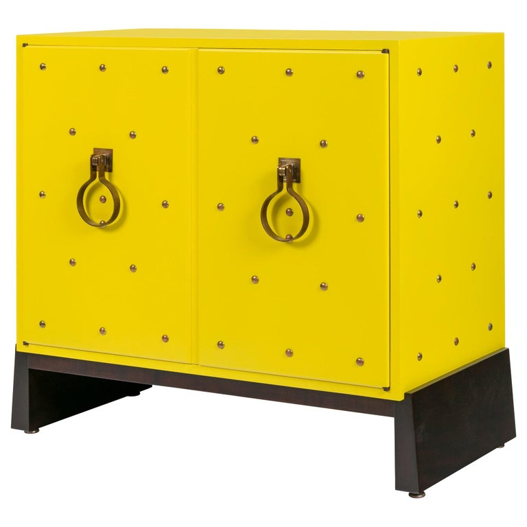 Tommy Parzinger Yellow Lacquered Studded Two-Door Cabinet, USA, 1950s For Sale