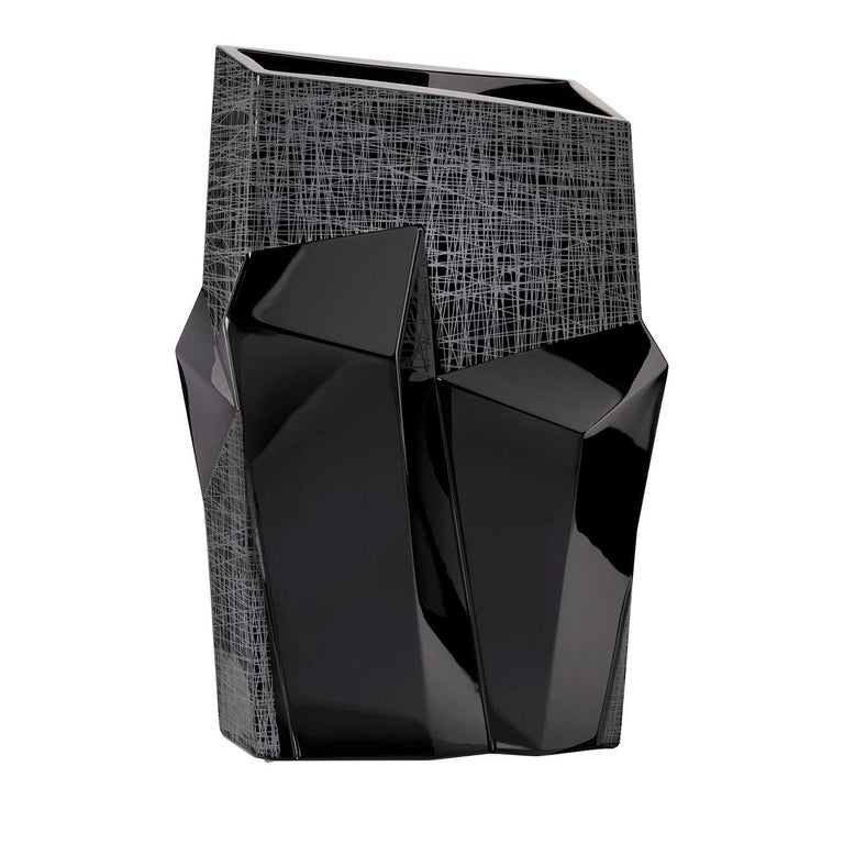 This stunning vase was crafted entirely of black crystal and its unique volumes are a celebration of Expressionist art. Dynamic and intriguing, the asymmetrical lines of this silhouette seem to have been pushed forward by an inner force with