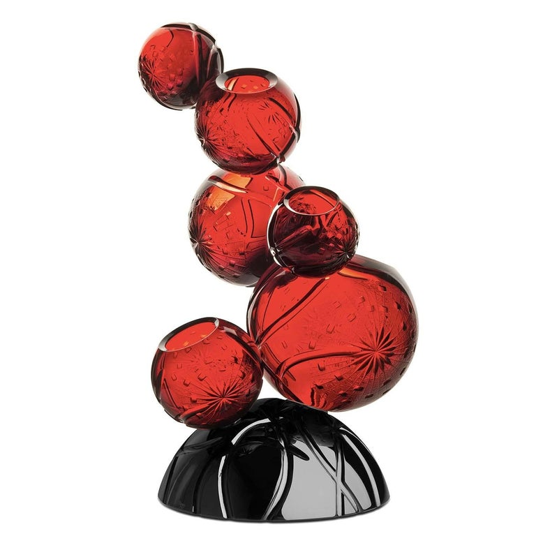 A superb addition to a modern or contemporary interior, this vase was crafted entirely of crystal and will make a statement in an entryway, living room, or study. The semi-spherical black base supports a total of six red spheres of different sizes,