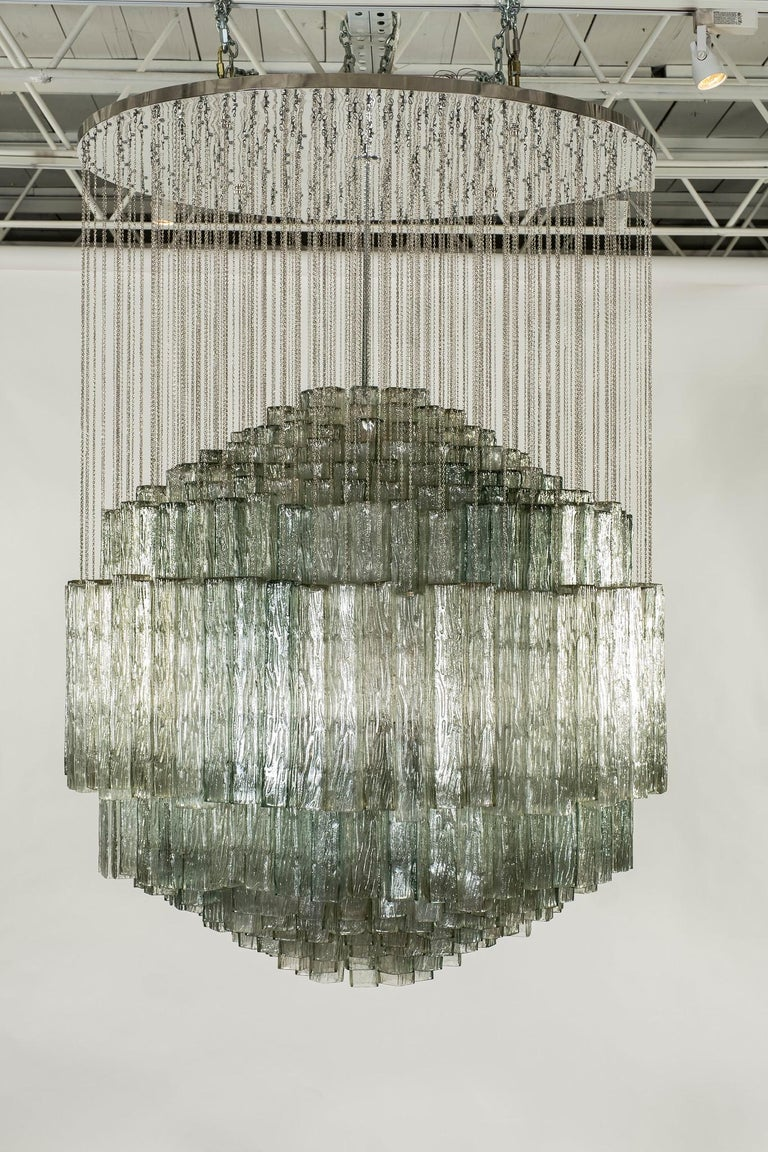 A monumental Toni Zuccheri for Venini glass and chrome chandelier. This magnificent chandelier is composed of 468+ hand blown textured glass prisms.