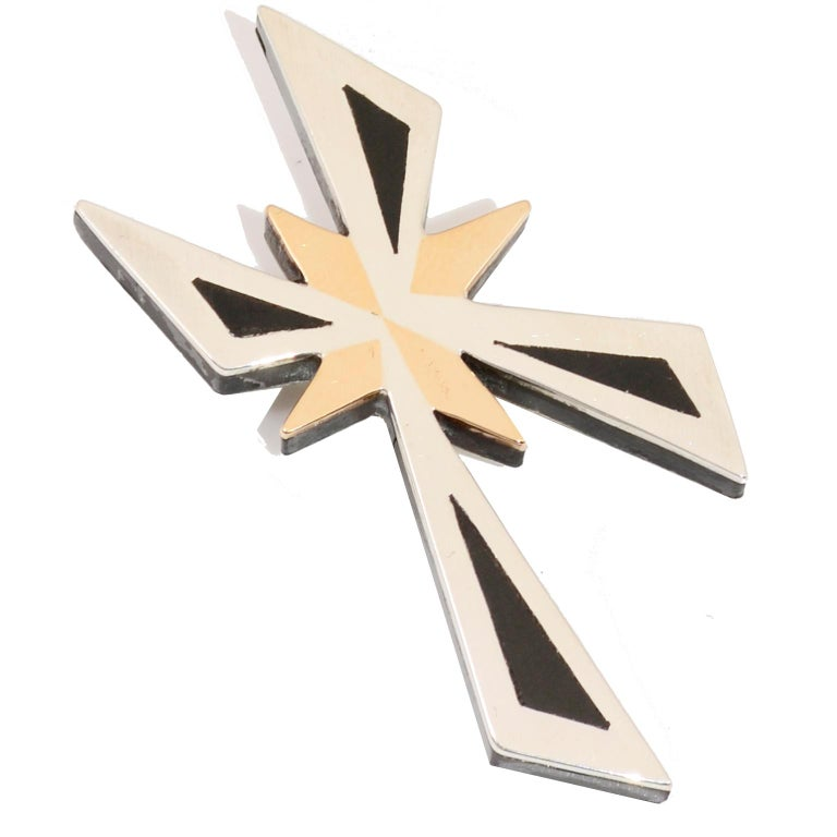 This is a lovely mixed metal sterling silver modernist mid century vintage cross pendant that can also be worn as a brooch. The piece is marked Hecho en Mexico CRA Signed TONO T-20 Sterling 925 Taxco  Piedra Negra. A light scratch in the brass star