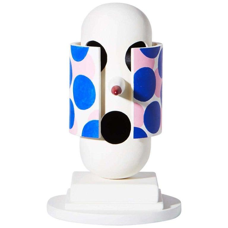 Tony Emilson Figurative Sculpture - «Undercover» figurative sculpture in painted wood