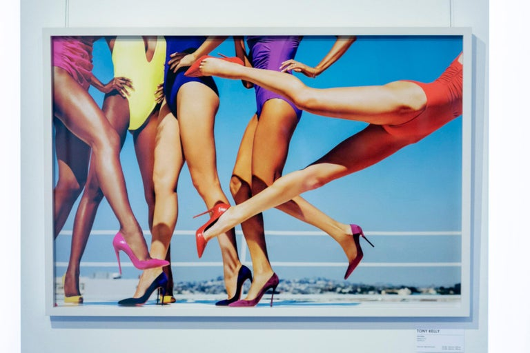 Cat Fight - female legs wearing colourful high heels  The artwork is framed with a white hardwood box and 99% UV-resistant acrylic glass. The artwork is made and signed by the artist in a strictly limited edition of 25. Other sizes on request.  A