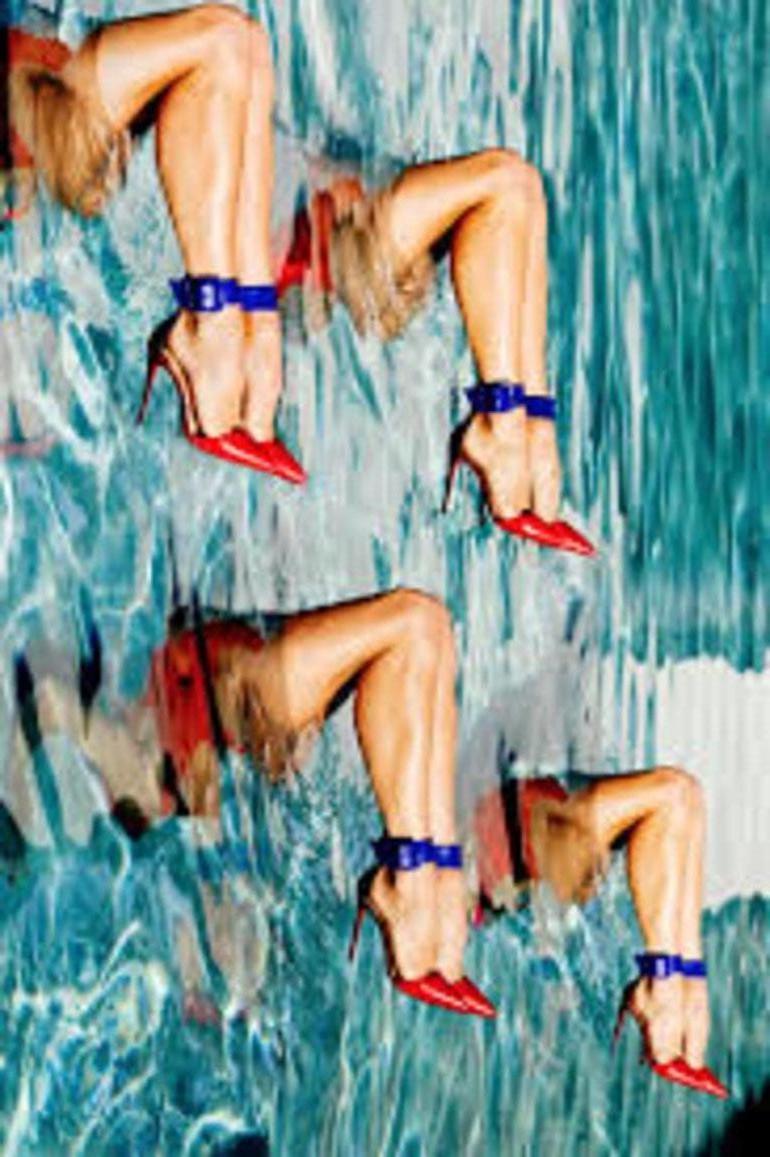 Footwork - colourful portrait of women legs in high heels in a blue swimmingpool
