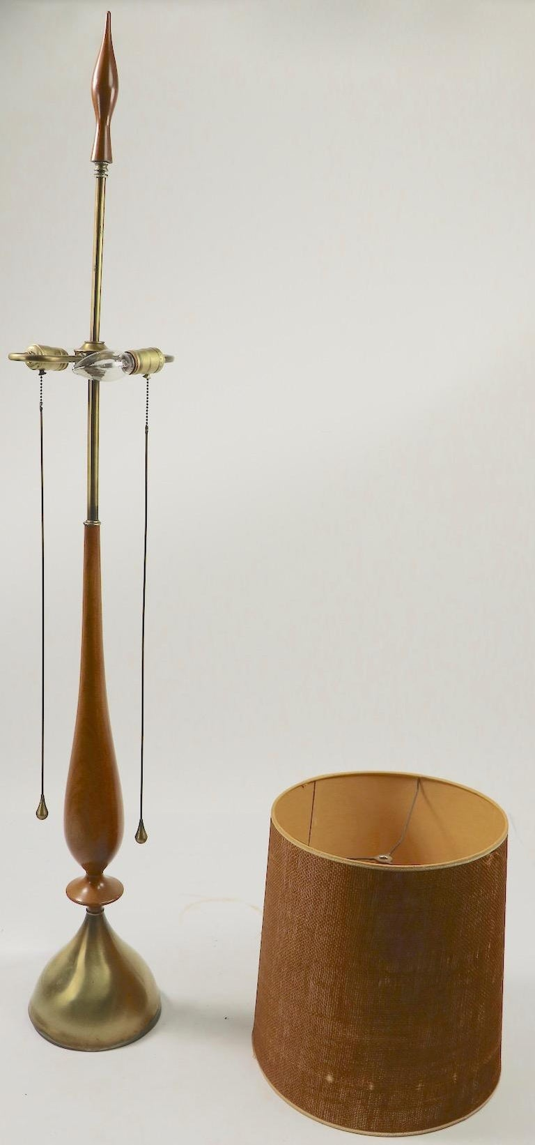 Exceptional elongated mid century table lamp designed by Tony Paul for Westwood Industries. This example is in very good, original and working condition, shade included but shows minor damage. Measures: Diameter of base 8 x diameter of Shade 13.5 x