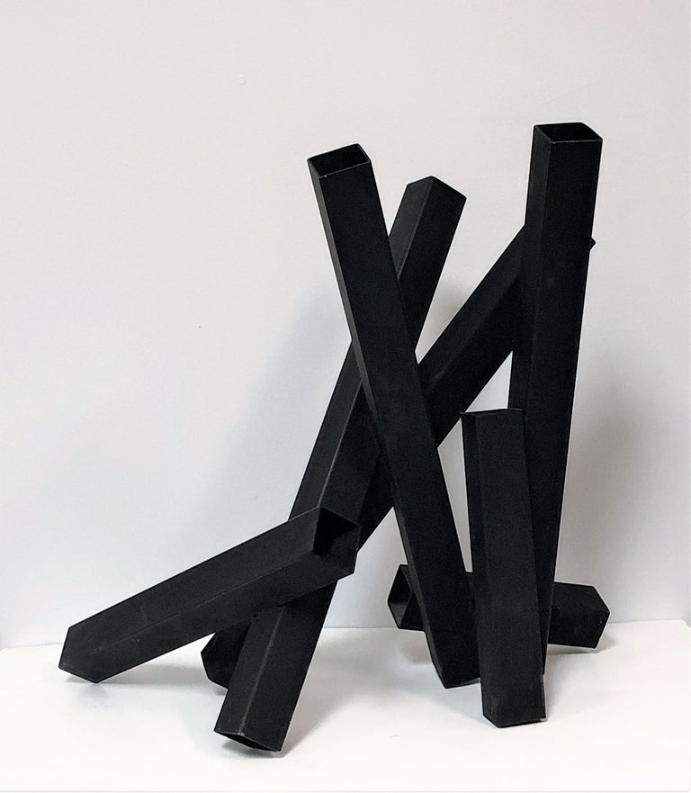 A steel sculpture with a black enamel finish. Nice size, could be displayed on a pedestal, on top of a table or on the floor.