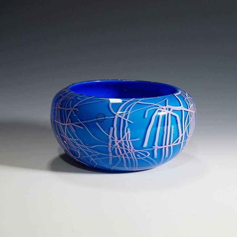 A vase of the 'folto' series in blue glass with lilac applications and clear overlay. Designed by toots zynsky circa 1984, manufactured by Venini, Venice in 1991. Incised signature 'zynsky venini 1991' on the base.  Lit.: franco deboni, venini