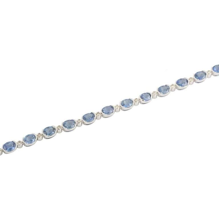 Oval Cut Topaz and Diamond Line Tennis Bracelet For Sale