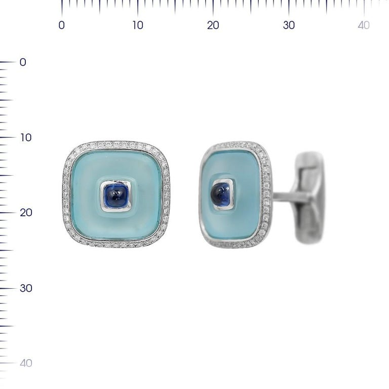 Cufflinks White Gold 18 K  Diamond 88-RND-0,34-G/VS1A Topaz 2-11,79ct Sapphire 2-0,95ct  Weight 16,75 grams  With a heritage of ancient fine Swiss jewelry traditions, NATKINA is a Geneva based jewellery brand, which creates modern jewellery