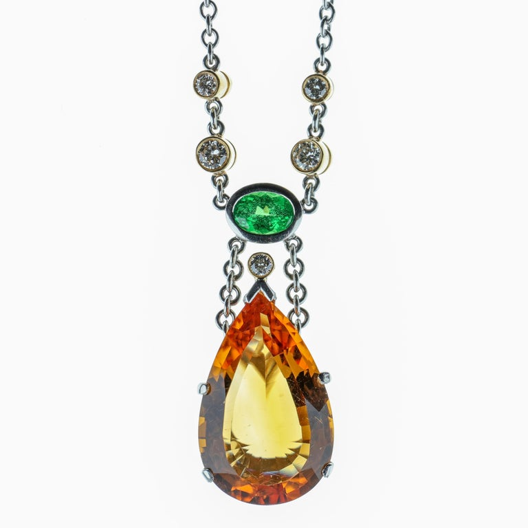 The reddish-pink and golden-orange varieties of topaz are known as imperial or precious topaz and they are rare. This hand-fabricated pendant is a one-of-a-kind original creation and features a magnificent internally flawless pear-shaped beautifully