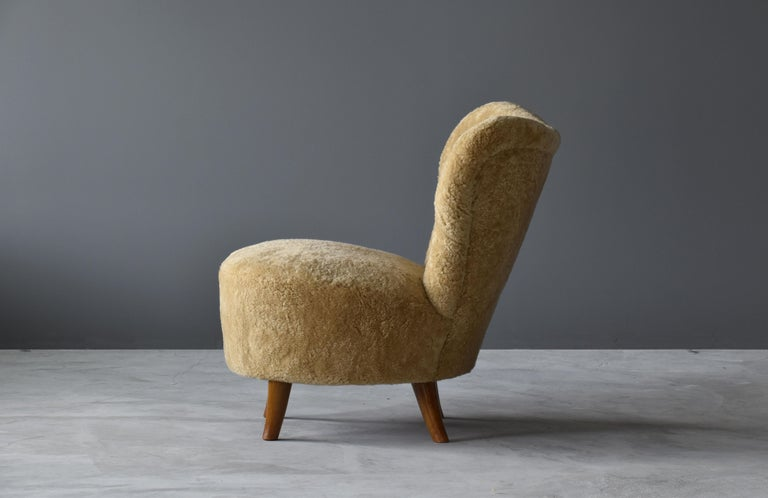 Tor Wolfenstein, Organic Lounge Chair, Sheepskin, Stained Beech, Ditzinger, 1940 In Excellent Condition For Sale In West Palm Beach, FL