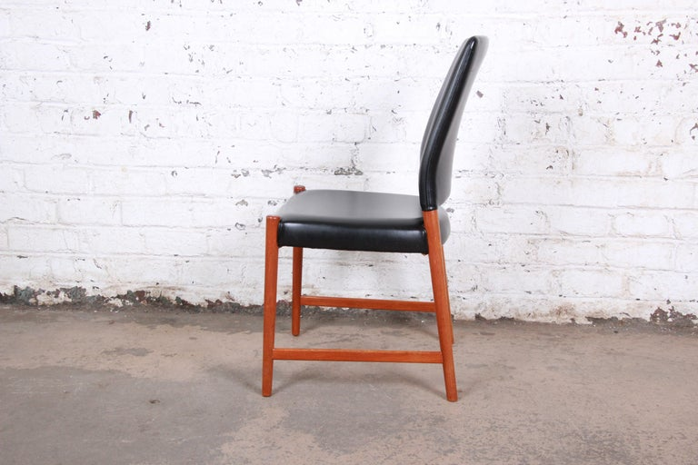 Mid-20th Century Torbjorn Afdal Teak and Black Leather Dining Chairs, Set of Four For Sale