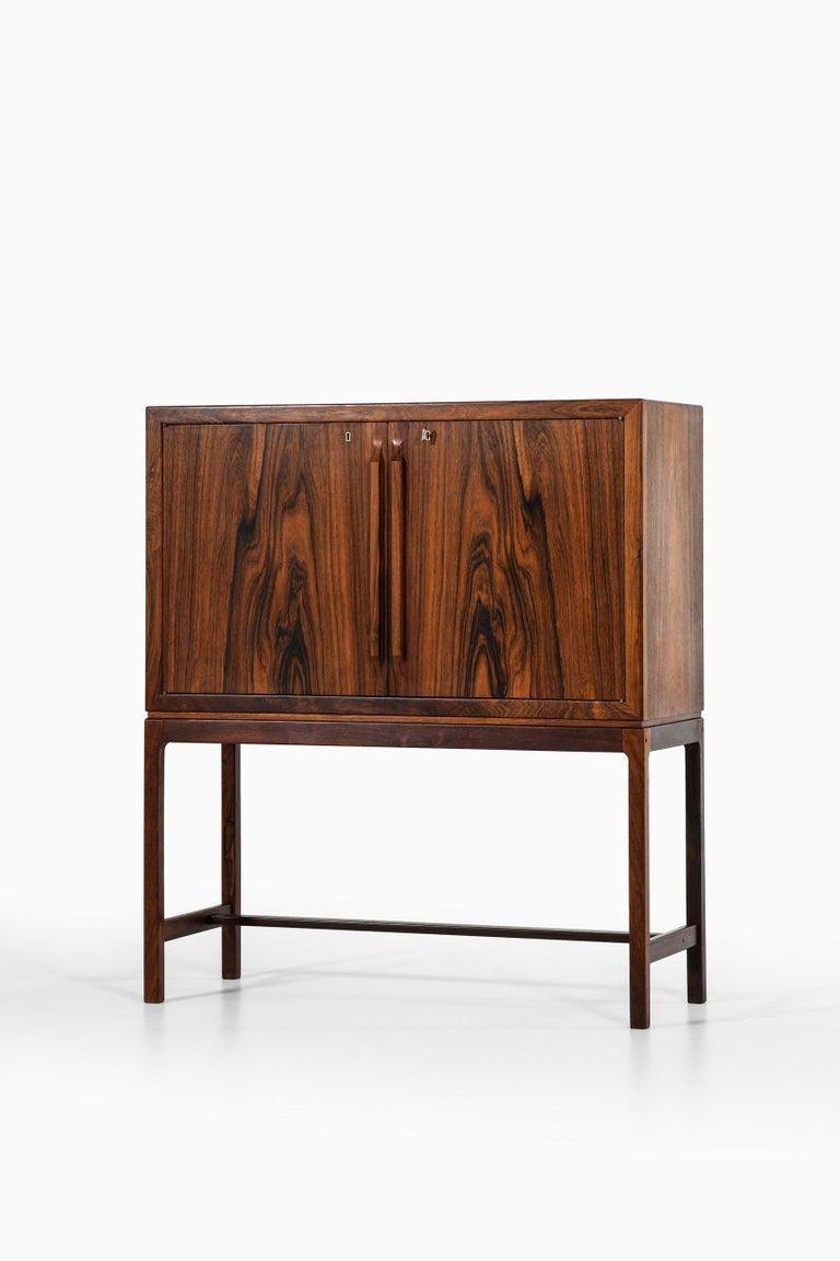 Rare bar cabinet designed by Torbjørn Afdal. Produced by Mellemstrands Møbelfabrik in Norway.