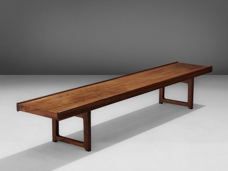 Torbjørn Afdal for Burksbo Mellemstrands Trevareindistri Norway, 'Krobo', side table or bench, rosewood,Norway, 1960s.  The 'Krobo' bench by Afdal is made out of rosewood the piece is one of the Classic Norwegian designs of the 1960s. It has two