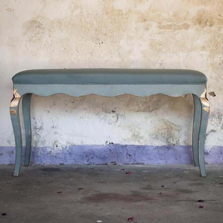 Entirely crafted and painted by hand in the classic Venetian style, this elegant wooden bench is a timeless accent piece to provide extra seating in a bedroom or living room. The rectangular base has an undulated border that flows gracefully into