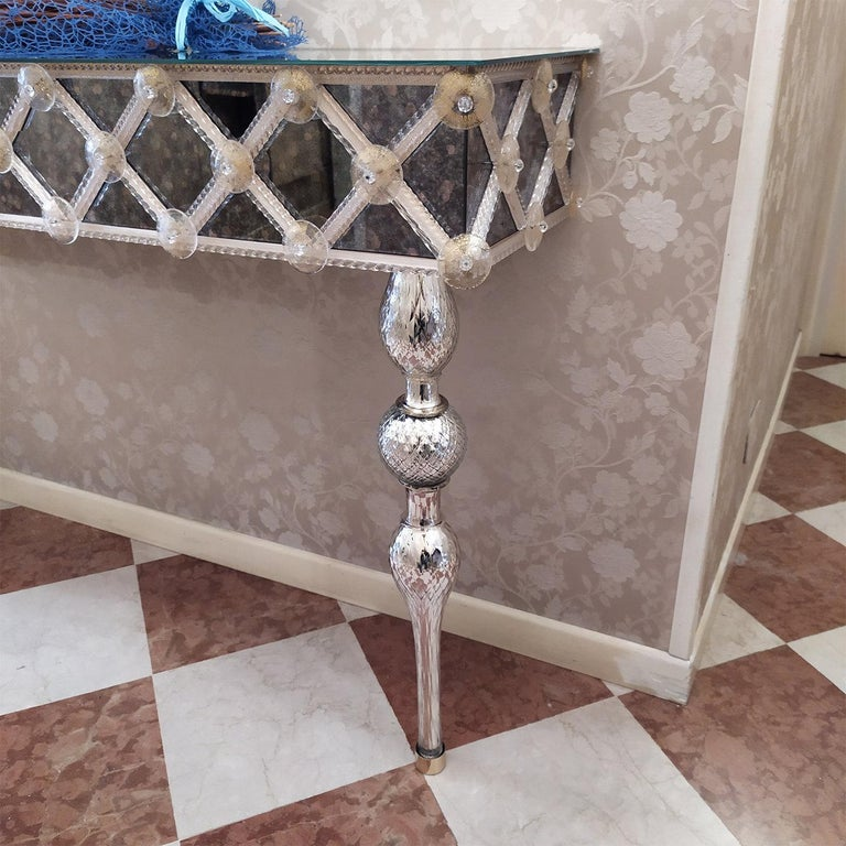 A sublime showcase of craftsmanship by expert artisans of the Venetian glassmaking tradition, this exceptional console will make a uniquely lavish accent in a refined entryway. Distinguished by meticulously applied details, it features a mirror top,
