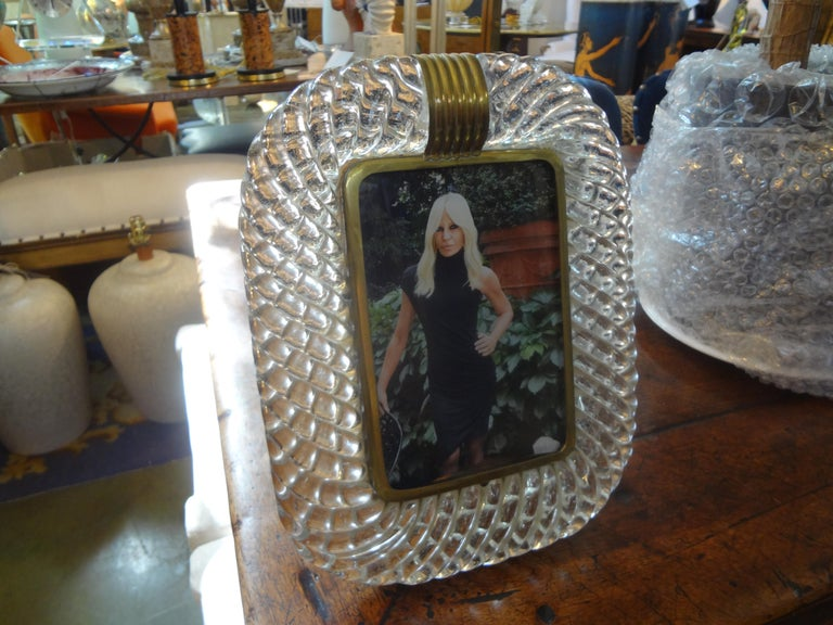 Stunning Treccia or Torchon twisted Murano glass and bronze photo frame by Venini. This vintage clear Italian Murano glass picture frame dates to the 1940s.