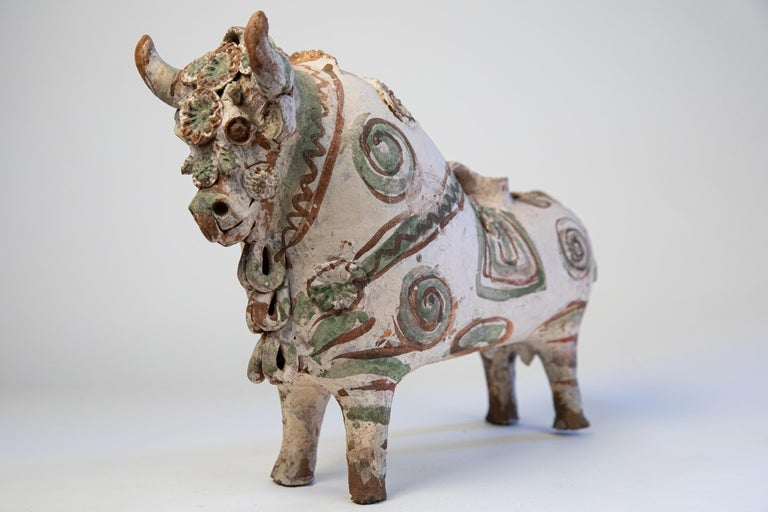 Vintage handcrafted Torito de Pucara terra cotta traditional Folk Art ceramic bull. Since 1908 these bulls or Torito de Pucaras have been traditionally sold at the Pucara train station. Originally used in marking ceremonies, cattle branding; for