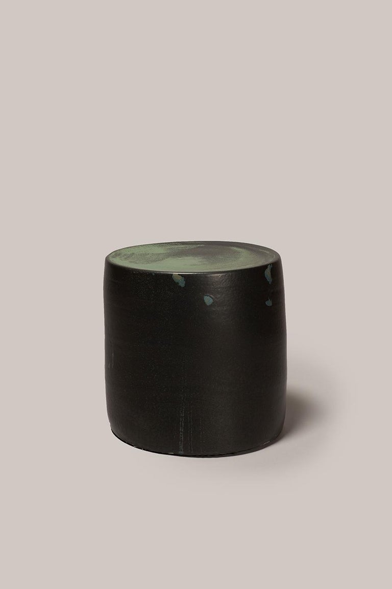 Hand thrown stoneware side table with three layers of glaze in multiple Fires 1290Cº. Measures: 400mm high, 350mm diameter.