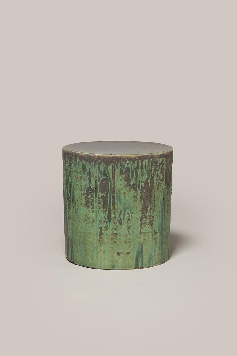 Hand thrown stoneware side table with two layers of glaze in multiple Fires 1290Cº. Measures: 400mm high, 350mm diameter.