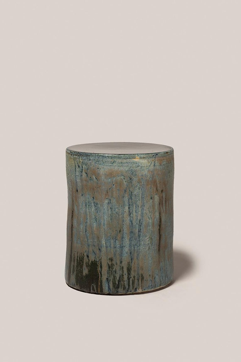 Hand thrown stoneware side table with four layers of glaze in multiple Fires 1290Cº. Measures: 430mm high, 350mm diameter.