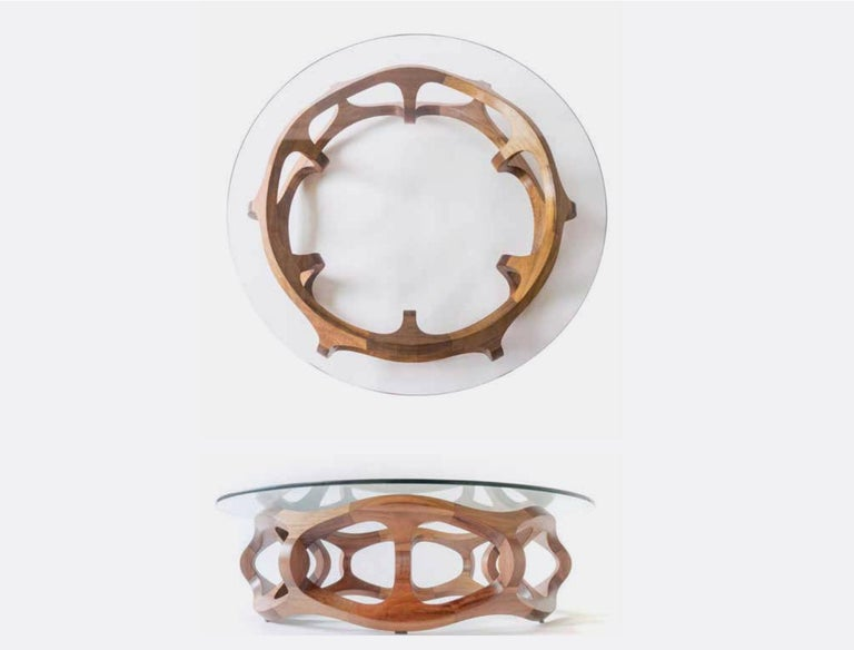 A low center table created with Tzalam wood pieces are cut from a single board of certified Tzalam wood and the assembly of the modules, the polishing of each part and the finish, in natural oil, is carried out manually.  The glass surface helps