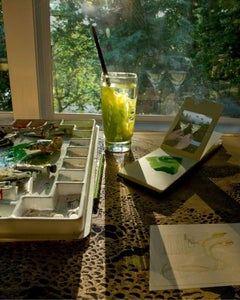 Gabriola Green - Sunlit artist studio still life w/ lush green forest, paints