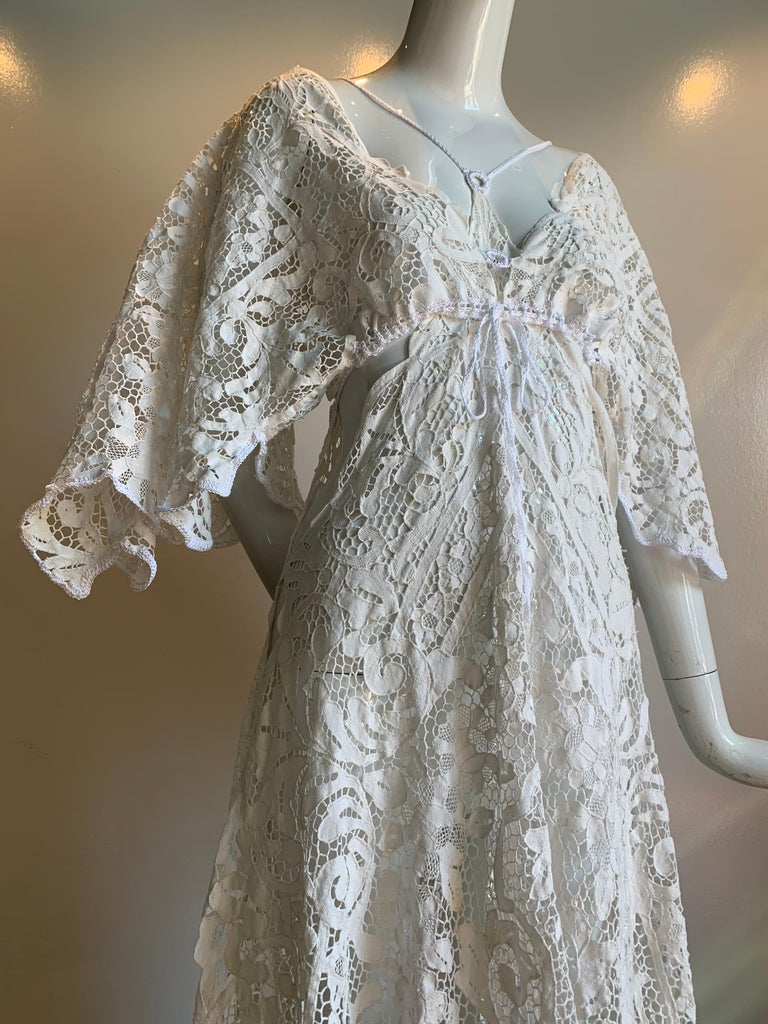 A sexy,  breezy and daring Torso Creations original that is perfect for a warm summer night!  Handmade vintage Belgian cotton lace is the base for this butterfly-sleeve bodice with flowing, figure hugging lace skirt. Deep plunging side details,
