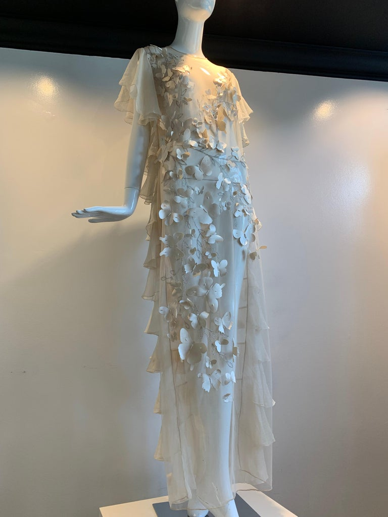 Torso Creations eggshell silk chiffon and tulle ruffled 1930s-inspired fantasy wedding gown with silk butterfly appliqués fashioned from a 1940s satin wedding dress. Front is a flat tulle panel, embroidered with silver branches and adorned with