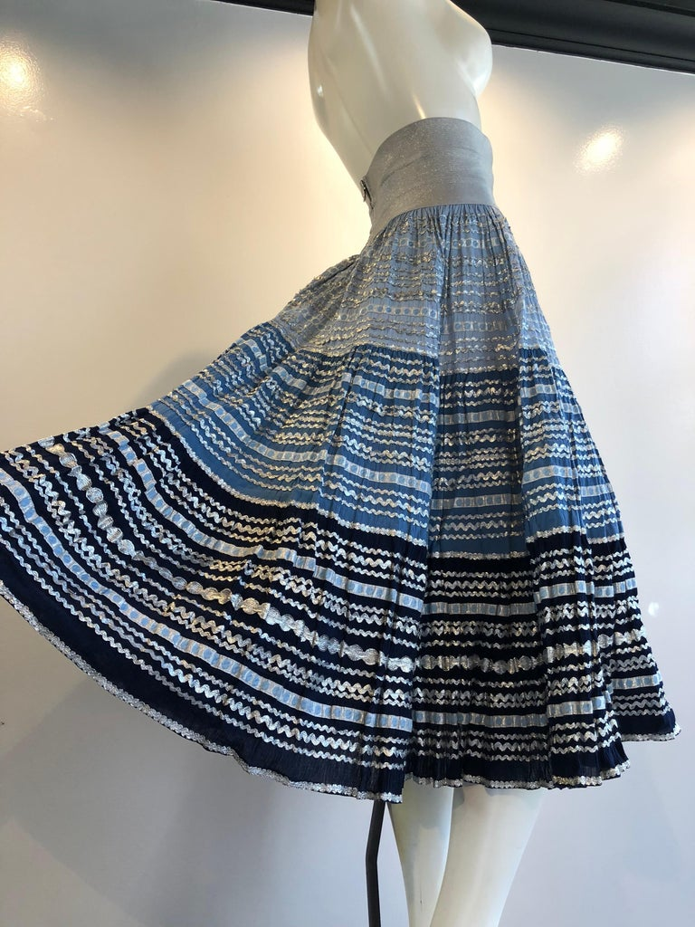 Torso Creations Modified 1950s High Elastic Waist Metallic Braid Circle Skirt.  Shades of blue and silver metallic rick-rack and ribbon thickly embellish a 1950s cotton circle skirt with a modern high elastic zippered waistband.