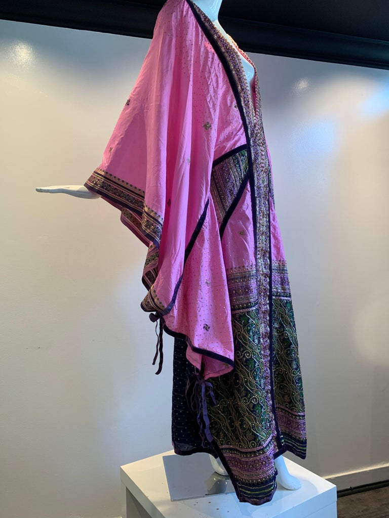 Torso Creations Pink Purple & Green Silk Caftan W/ Open Back, Embroidery, Purple Velvet Ribbon and Sequin Trim. Fashioned from vintage sari fabric in the style of Thea Porter. Adjustable drawstrings and ties. Deep plunging V- neckline.