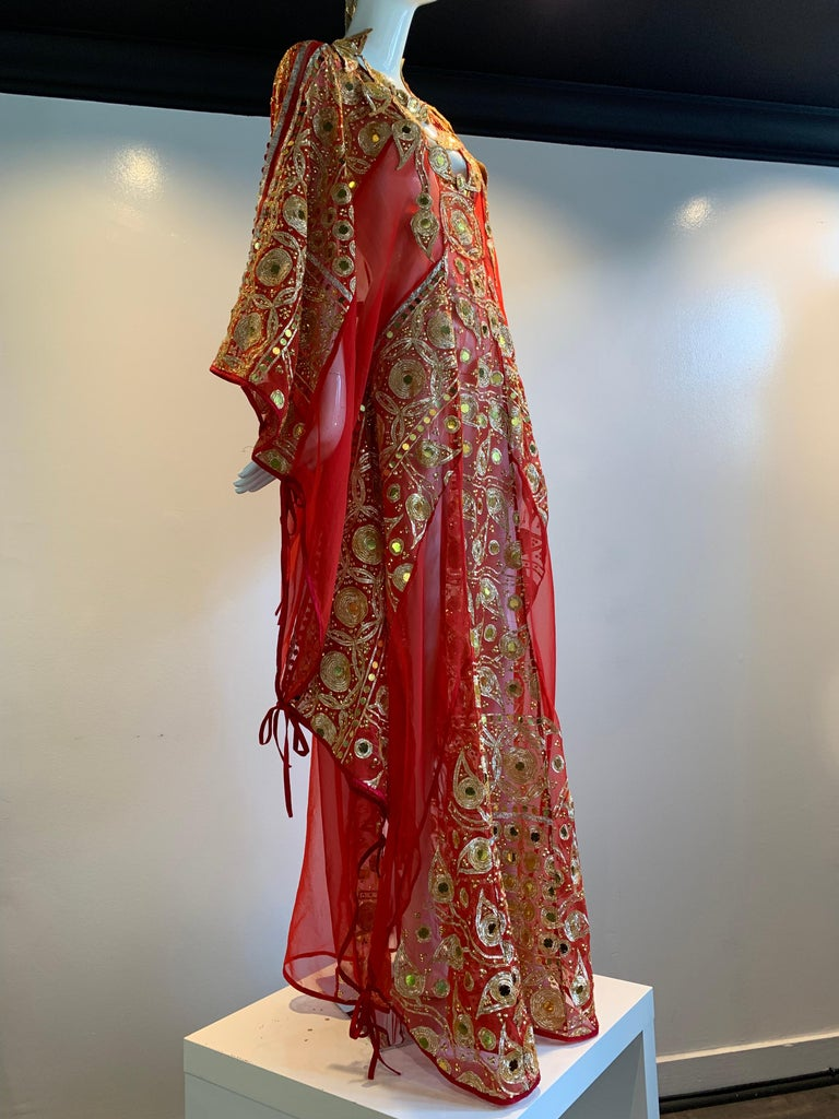 Torso Creations Red Silk Chiffon Caftan Heavily Embroidered W/ Gold & Sequins. One of a kind and uniquely fashioned from vintage red silk chiffon sari fabric in the style of Thea Porter. Fabric ties together at sides to give adjustibility in size