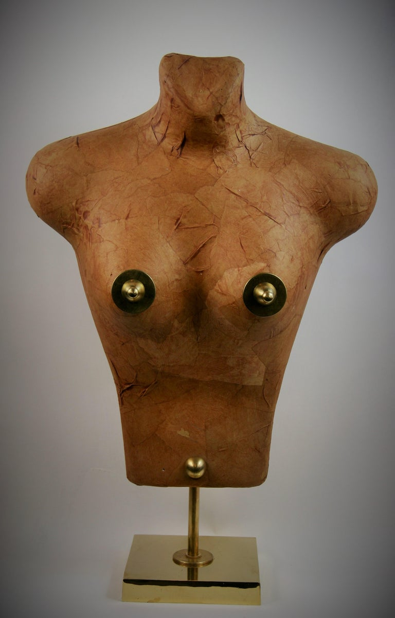 8-273 Torso sculpture made from Japanese paper applied to a foam structure embellished with brass on a polished brass base created by Brunelli in 1985.