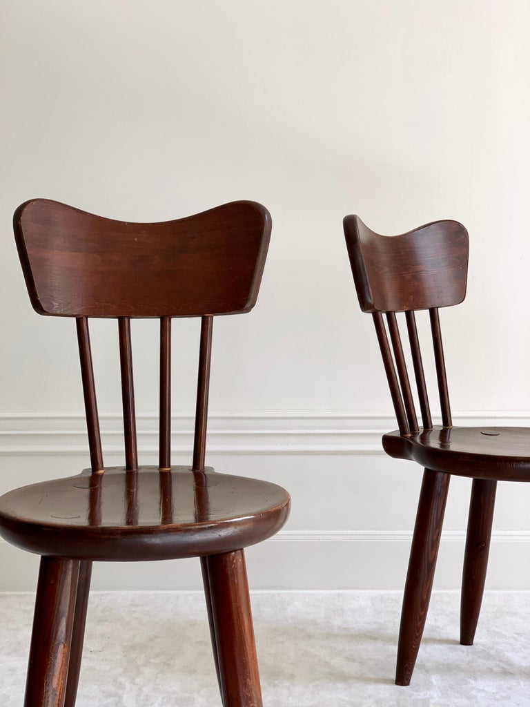 Rare set of four dining chairs by Torsten Claeson in stained pine for Steneby Hemslöjd. In good vintage condition.