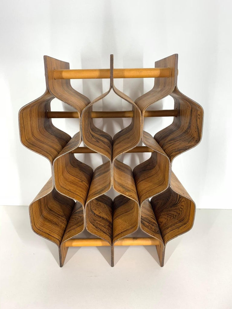 Rosewood wine rack by Swedish designer, Torsten Johansson (1917-1996) for Ab Formträ. Holds 8 bottles. Signed. Excellent example of Minimalist Mid-Century Modern design. Very good condition with one slight discoloration on rear corner of lower level