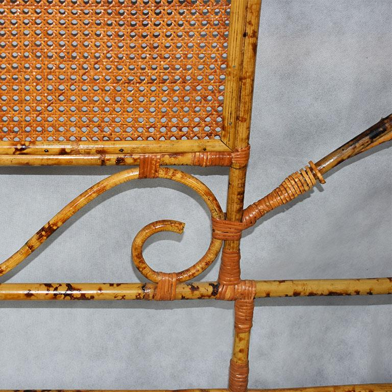 Beautiful tortoiseshell bamboo or burnt bamboo full-size headboard. This lovely piece features bentwood rounded corners at the top, with a pagoda-like crown also in bentwood. Scrolled pieces of tortoise bamboo throughout, and a woven cane webbed